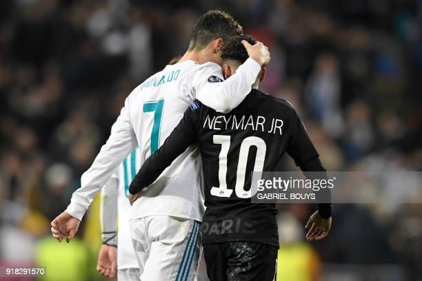 TOPSHOT Real Madrid's Portuguese forward Cristiano Ronaldo and Paris SaintGermain's Brazilian forward Neymar leave the pitch at halftime during the...