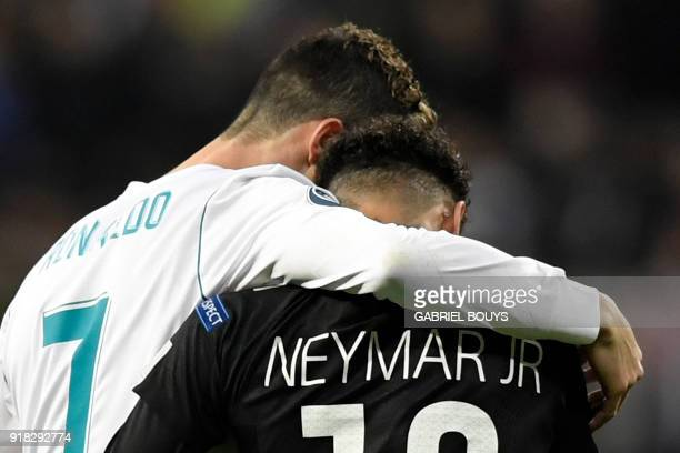 TOPSHOT Real Madrid's Portuguese forward Cristiano Ronaldo and Paris SaintGermain's Brazilian forward Neymar leave the pitch during the UEFA...