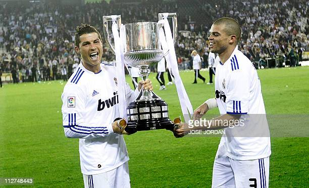 Real Madrid's Portuguese forward Cristiano Ronaldo and Real Madrid's Portuguese defender Pepe celebrate with the trophy after winning the Spanish Cup...