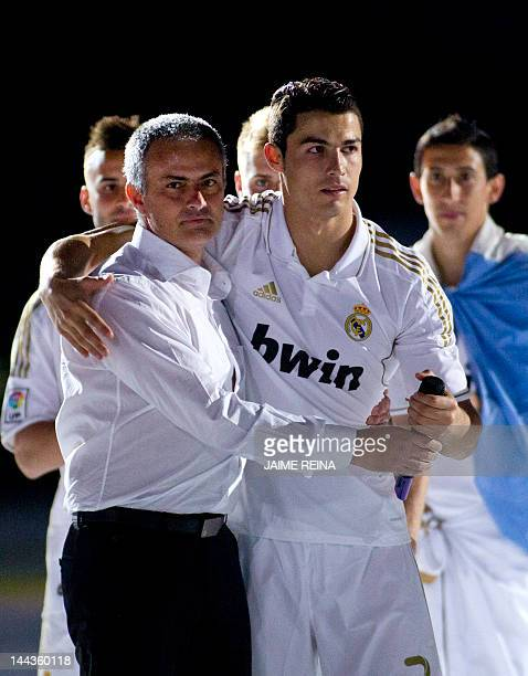 Real Madrid's Portuguese forward Cristiano Ronaldo and Real Madrid's Portuguese coach Jose Mourinho celebrate winning Spanish League title on May 13...