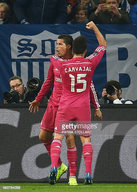 Real Madrid's Portuguese forward Cristiano Ronaldo and Real Madrid's defender Dani Carvajal celebrate after Ronaldo scored during the last sixteen...