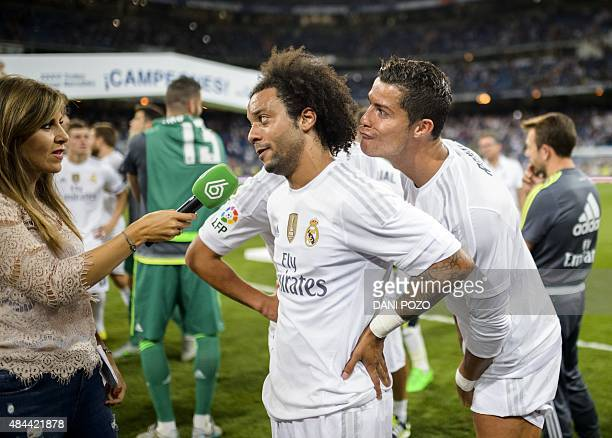 Real Madrid's Portuguese forward Cristiano Ronaldo and Real Madrid's Brazilian defender Marcelo gesture as they answer a journalist after their...