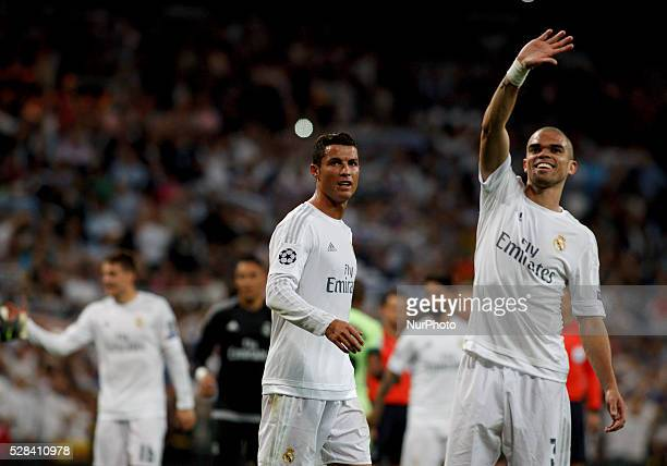 Real Madrid's Portuguese forward Cristiano Ronaldo and Real Madrid's Portuguese player Pepe celebarates victory during the Champions League 2015/16...