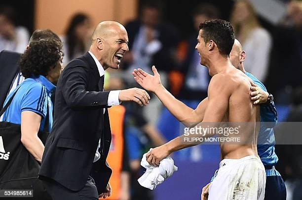Real Madrid's Portuguese forward Cristiano Ronaldo and Real Madrid's French coach Zinedine Zidane celebrate after Real Madrid won the UEFA Champions...