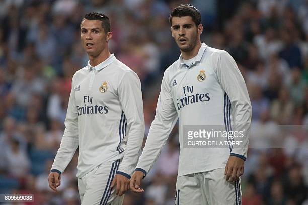 Real Madrid's Portuguese forward Cristiano Ronaldo and Real Madrid's forward Alvaro Morata look on during the Spanish league football match Real...