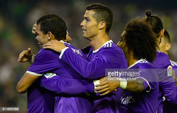 Real Madrid's Portuguese forward Cristiano Ronaldo and Real Madrid's Portuguese defender Pepe congratulates Real Madrid's midfielder Isco after he...