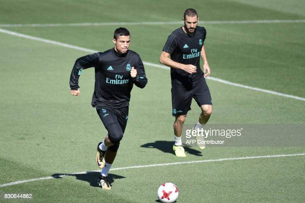 Real Madrid's Portuguese forward Cristiano Ronaldo and Real Madrid's French forward Karim Benzema take part in a training session at Real Madrid...