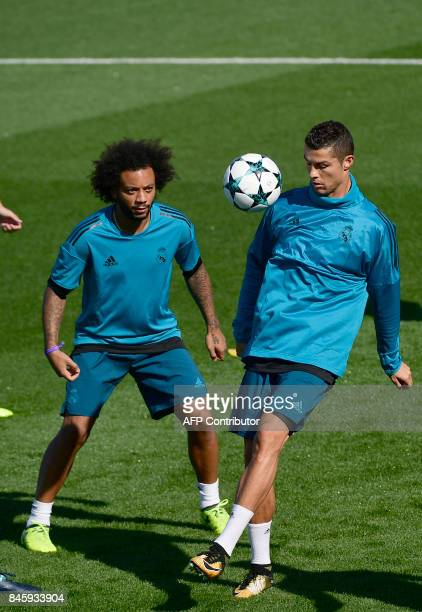 Real Madrid's Portuguese forward Cristiano Ronaldo and Real Madrid's Croatian midfielder Luka Modric attend a training session at the Valdebebas...