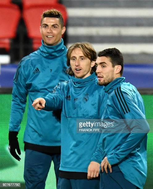 Real Madrid's Portuguese forward Cristiano Ronaldo and Real Madrid's Croatian midfielder Luka Modric take part in a training session at the Parc des...