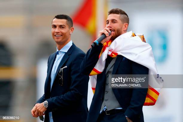 TOPSHOT Real Madrid's Portuguese forward Cristiano Ronaldo and Real Madrid's Spanish defender Sergio Ramos celebrate at Cibeles square in Madrid on...