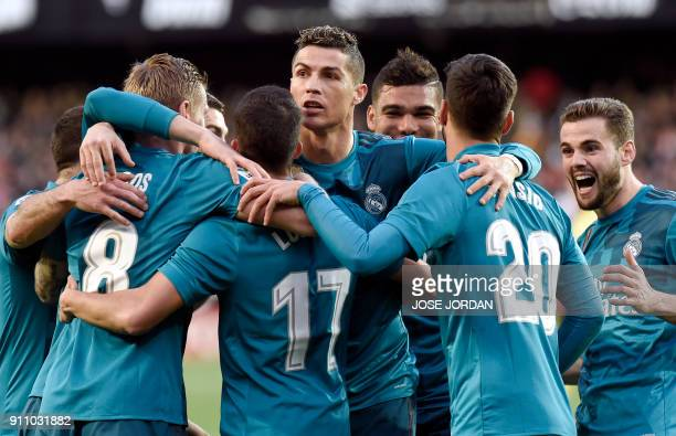 TOPSHOT Real Madrid's Portuguese forward Cristiano Ronaldo and teammates celebrate Real Madrid's German midfielder Toni Kroos' goal during the...