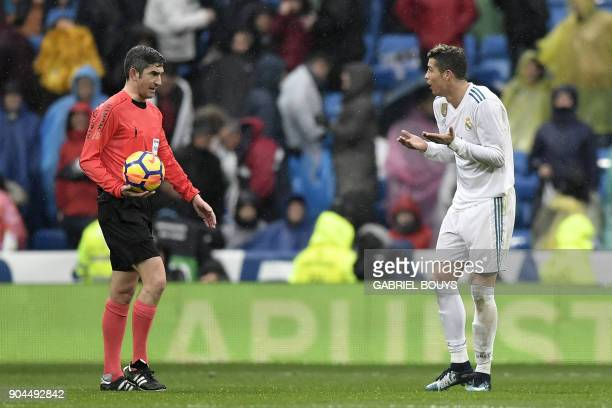 Real Madrid's Portuguese forward Cristiano Ronaldo appeals for a penalty from Spanish referee Alberto Undiano during the Spanish league football...