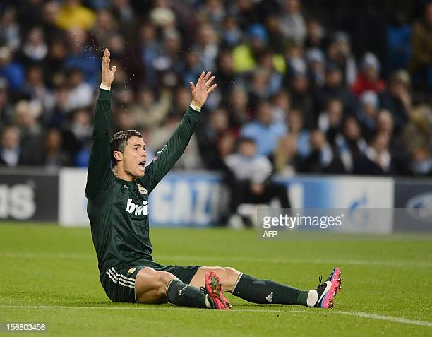 Real Madrid's Portuguese forward Cristiano Ronaldo appeals from the ground during the UEFA Champions League Group D football match between Manchester...