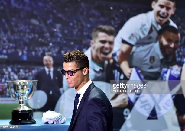 Real Madrid's Portuguese forward Cristiano Ronaldo arrives at the Madrid Town hall on Plaza Cibeles in Madrid on May 22 2017 during a celeration...