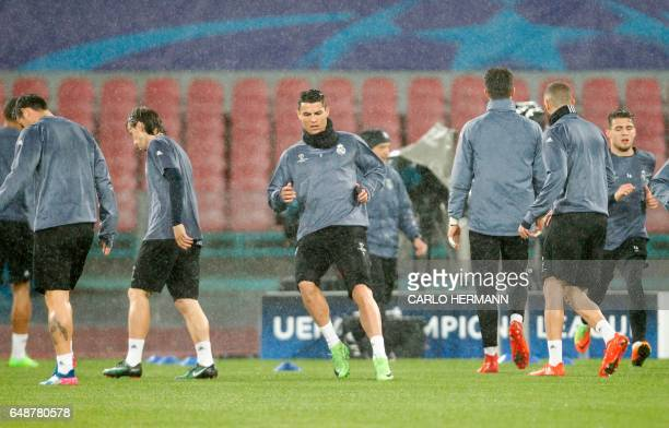 Real Madrid's Portuguese forward Cristiano Ronaldo attends a training session with teammates on the eve of the Champions League football match Napoli...