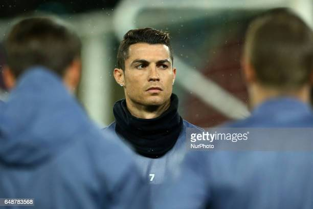 Real Madrid's Portuguese forward Cristiano Ronaldo attends a training session under heavy rain on the eve of the Champions League football match...