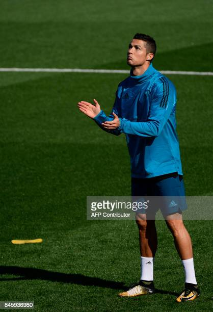 Real Madrid's Portuguese forward Cristiano Ronaldo attends a training session at the Valdebebas Sport City in Madrid on September 12 2017 on the eve...