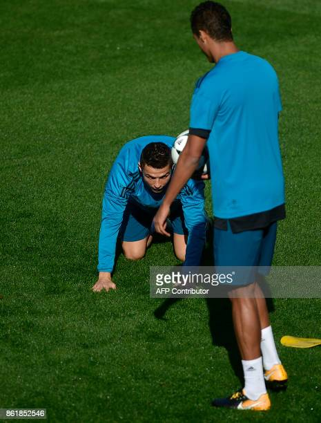 Real Madrid's Portuguese forward Cristiano Ronaldo attends a training session at Valdebebas Sport City in Madrid on October 16 2017 on the eve of a...