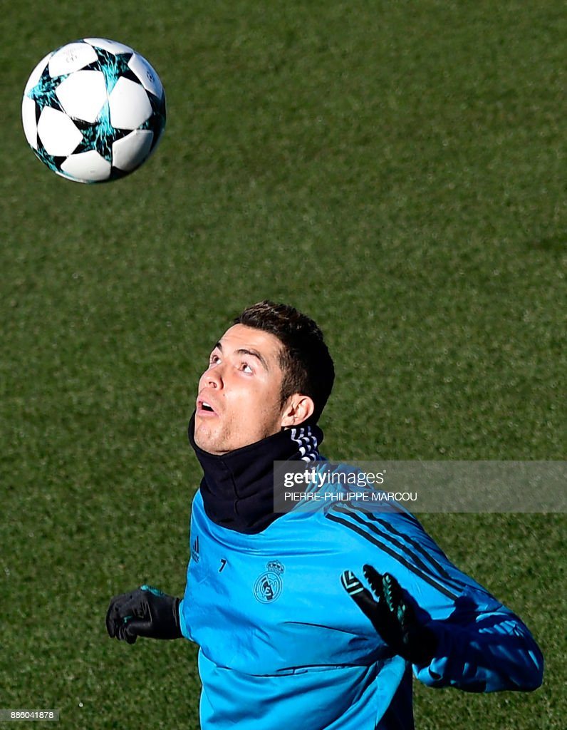 Real Madrid's Portuguese forward Cristiano Ronaldo attends a training session at Valdebebas Sport City in Madrid on December 5, 2017 on the eve of their Champions' League match against Borussia Dortmund. /