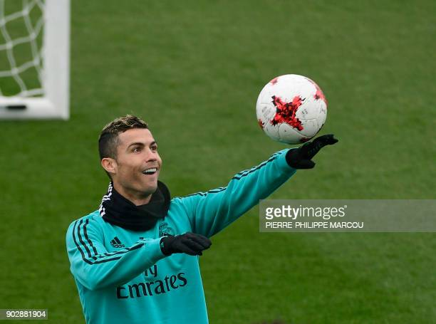 TOPSHOT Real Madrid's Portuguese forward Cristiano Ronaldo attends a training session at Valdebebas Sport City in Madrid on January 9 2018 / AFP...