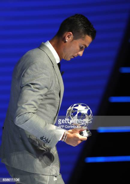 Real Madrid's Portuguese forward Cristiano Ronaldo carries the trophy after he was awarded the title of 'Best Forward in Europe' during the UEFA...