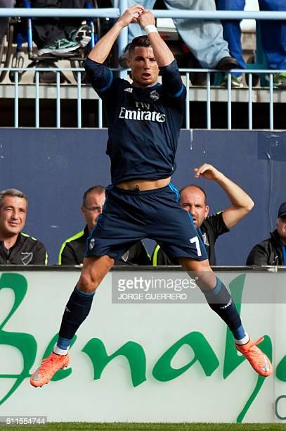 Real Madrid's Portuguese forward Cristiano Ronaldo celebrates a goal during the Spanish league football match Malaga CF vs Real Madrid CF at La...