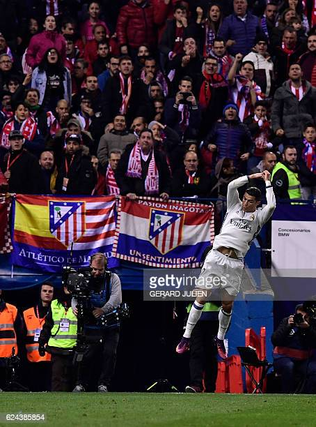 Real Madrid's Portuguese forward Cristiano Ronaldo celebrates a goal during the Spanish league football match between Club Atletico de Madrid and...