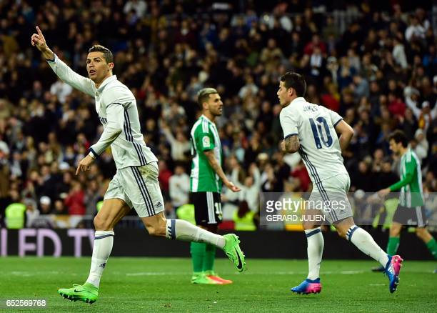 TOPSHOT Real Madrid's Portuguese forward Cristiano Ronaldo celebrates a goal beside Real Madrid's Colombian midfielder James Rodriguez during the...