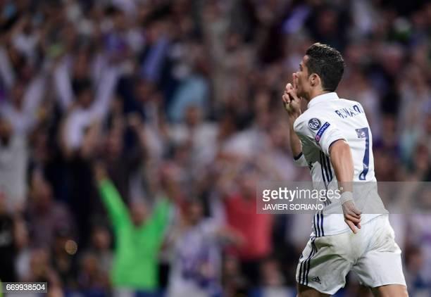 Real Madrid's Portuguese forward Cristiano Ronaldo celebrates a goal during the UEFA Champions League quarterfinal second leg football match Real...