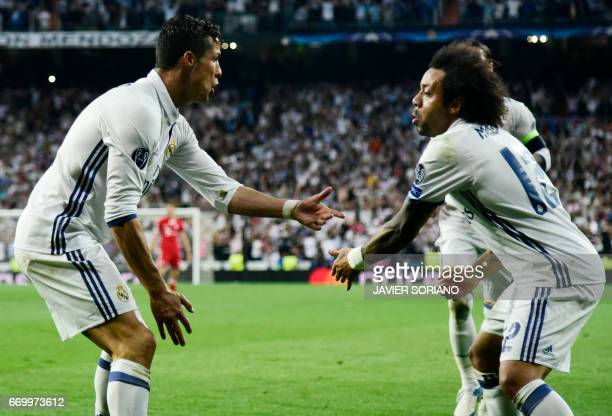 Real Madrid's Portuguese forward Cristiano Ronaldo celebrates a goal with Real Madrid's Brazilian defender Marcelo during the UEFA Champions League...