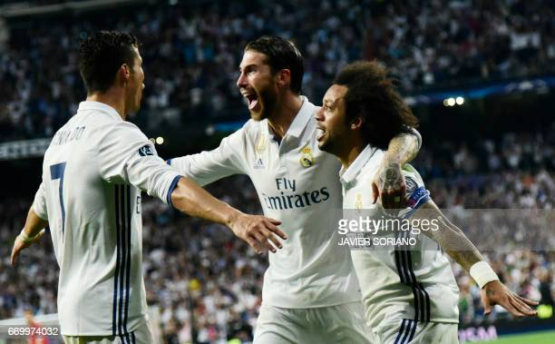 Real Madrid's Portuguese forward Cristiano Ronaldo celebrates a goal with Real Madrid's Brazilian defender Marcelo and Real Madrid's defender Sergio...
