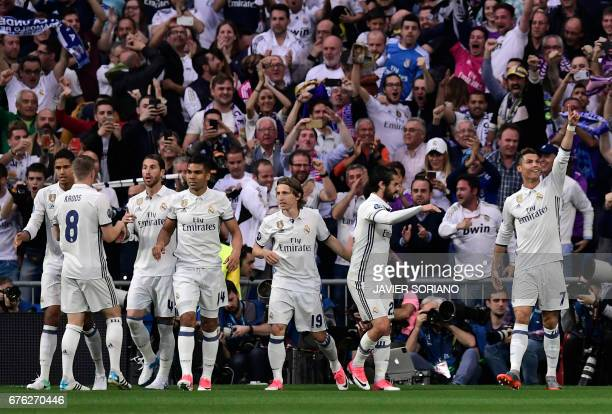 Real Madrid's Portuguese forward Cristiano Ronaldo celebrates a goal during the UEFA Champions League semifinal first leg football match Real Madrid...
