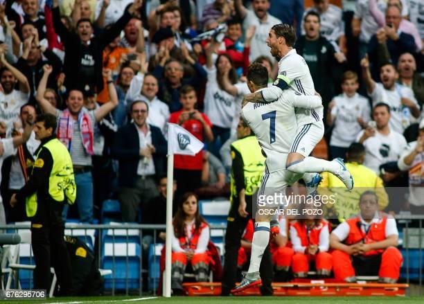 Real Madrid's Portuguese forward Cristiano Ronaldo celebrates a goal with Real Madrid's defender Sergio Ramos during the UEFA Champions League...