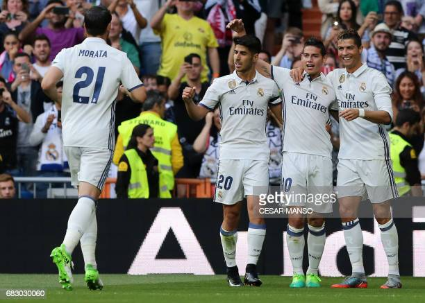 Real Madrid's Portuguese forward Cristiano Ronaldo celebrates a goal with Real Madrid's Colombian midfielder James Rodriguez and Real Madrid's...