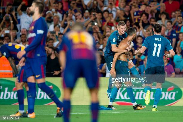 Real Madrid's Portuguese forward Cristiano Ronaldo celebrates a goal with teammate Real Madrid's German midfielder Toni Kroos during the first leg of...