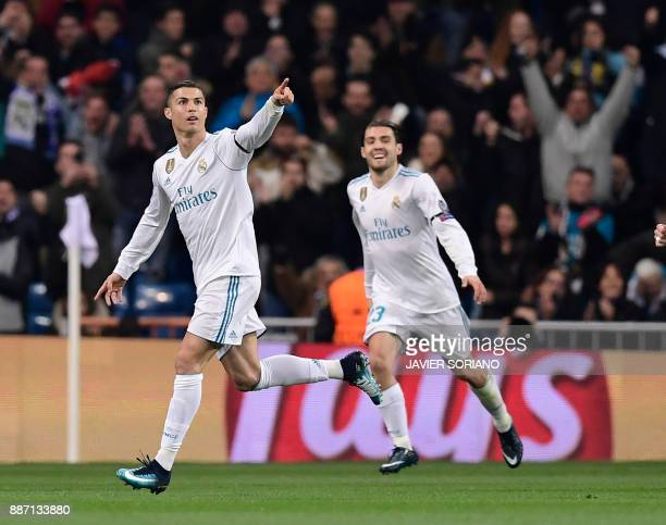 Real Madrid's Portuguese forward Cristiano Ronaldo celebrates a goal beside Real Madrid's Croatian midfielder Mateo Kovacic during the UEFA Champions...