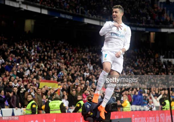 Real Madrid's Portuguese forward Cristiano Ronaldo celebrates a goal during the Spanish League football match between Real Madrid CF and Girona FC at...