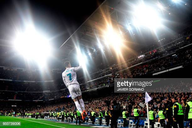 TOPSHOT Real Madrid's Portuguese forward Cristiano Ronaldo celebrates a goal during the Spanish League football match between Real Madrid CF and...