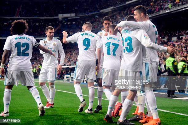 Real Madrid's Portuguese forward Cristiano Ronaldo celebrates a goal with teammates during the Spanish League football match between Real Madrid CF...