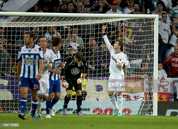 Real Madrid's Portuguese forward Cristiano Ronaldo celebrates after scoring a penalty shot during the Spanish League football match Real Madrid vs...