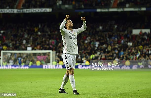 Real Madrid's Portuguese forward Cristiano Ronaldo celebrates after scoring a goal during the Spanish league football match Real Madrid CF vs RC...