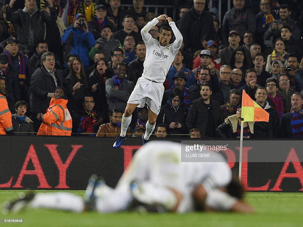 Real Madrid's Portuguese forward Cristiano Ronaldo celebrates after scoring a goal during the Spanish league 'Clasico' football match FC Barcelona vs Real Madrid CF at the Camp Nou stadium in Barcelona on April 2, 2016. / AFP / LLUIS