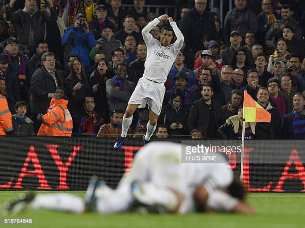 Real Madrid's Portuguese forward Cristiano Ronaldo celebrates after scoring a goal during the Spanish league 'Clasico' football match FC Barcelona vs...