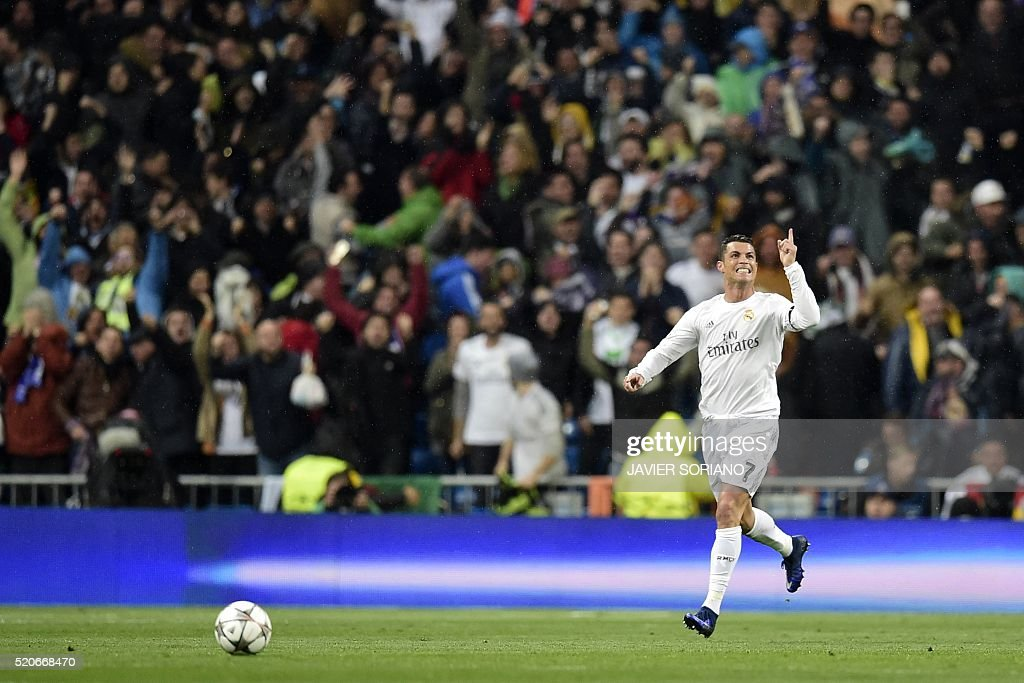 Real Madrid's Portuguese forward Cristiano Ronaldo celebrates after scoring a goal during the Champions League quarter-final second leg football match Real Madrid vs Wolfsburg at Santiago Bernabeu stadium in Madrid on April 12, 2016. / AFP / JAVIER