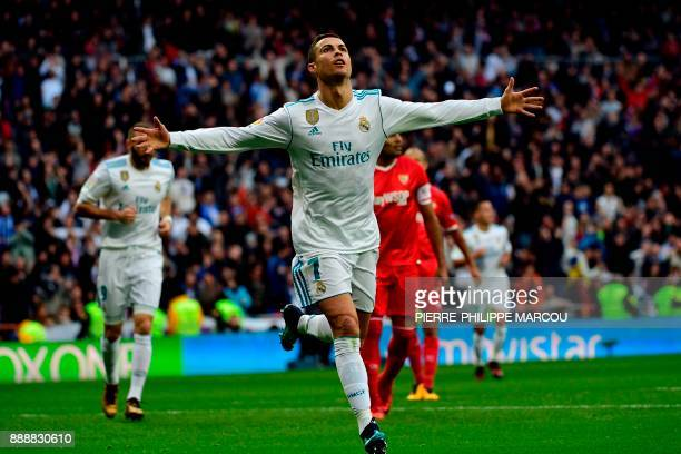 TOPSHOT Real Madrid's Portuguese forward Cristiano Ronaldo celebrates after scoring a goal during the Spanish league football match between Real...