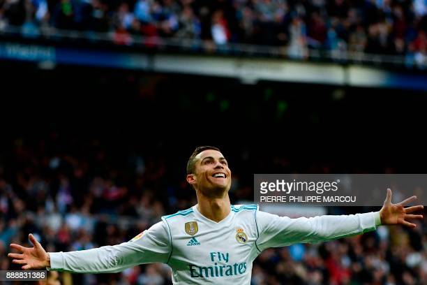 Real Madrid's Portuguese forward Cristiano Ronaldo celebrates after scoring a goal during the Spanish league football match between Real Madrid and...