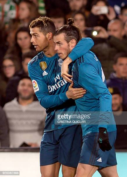 Real Madrid's Portuguese forward Cristiano Ronaldo celebrates after scoring a goal with Real Madrid's Welsh forward Gareth Bale during the Spanish...