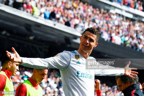 Real Madrid's Portuguese forward Cristiano Ronaldo celebrates after scoring a goal during the Spanish league football match between Real Madrid CF...