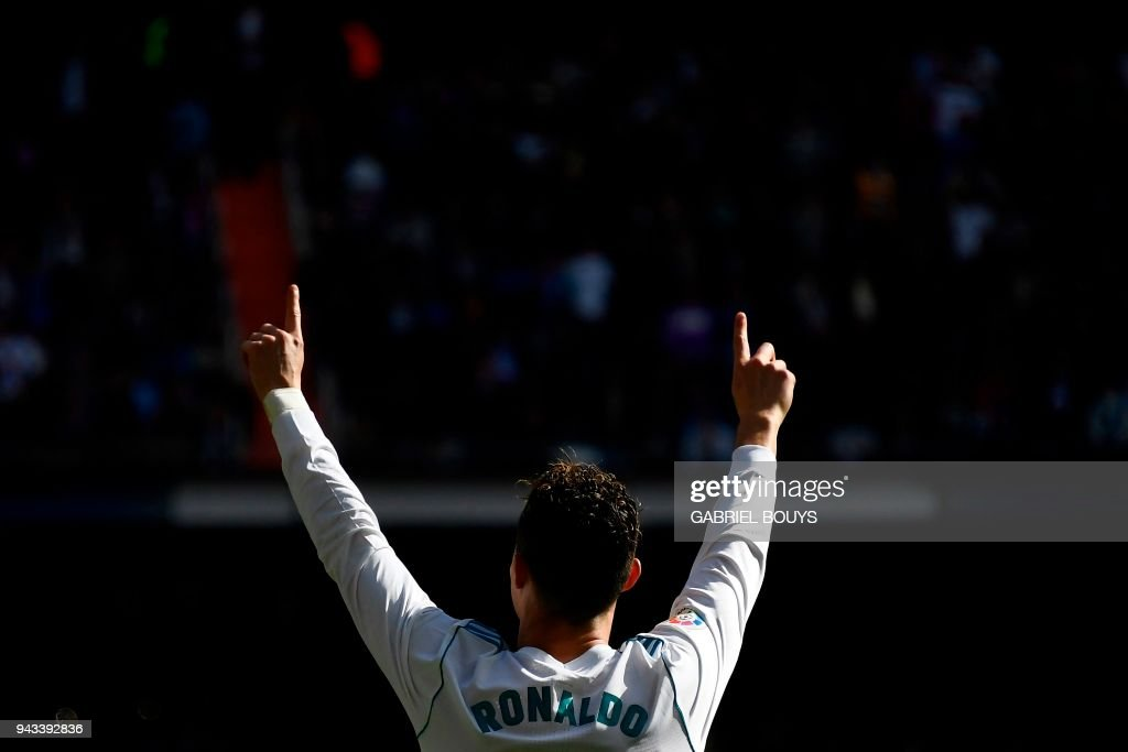 Real Madrid's Portuguese forward Cristiano Ronaldo celebrates after scoring a goal during the Spanish league football match between Real Madrid CF and Club Atletico de Madrid at the Santiago Bernabeu stadium in Madrid on April 8, 2018. /