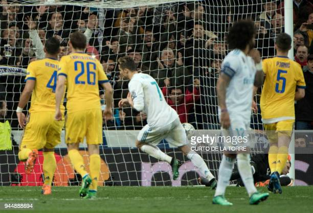 Real Madrid's Portuguese forward Cristiano Ronaldo celebrates after shooting a penalty kick to score a goal during the UEFA Champions League...